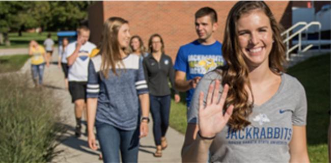 Image of students walking and waving